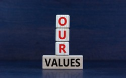 Our values symbol. Wooden cubes and block with words 'our values' on beautiful grey background. Business and our values concept, copy space.