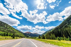 Ouray scenic byway in summer Million Dollar Highway 550 road in Colorado driving pov and Engineer mountain peak to Durango and Silverton