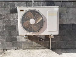 Ourdoor air conditioner split component attached to the wall.