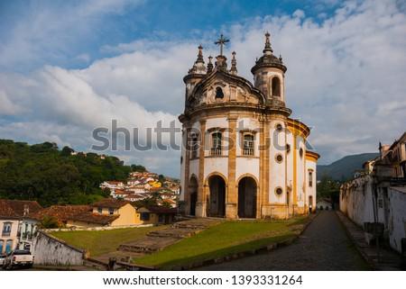 Ouro Preto, Minas Gerais, Brazil: The famous Church of Saint Francis of Assisi, a Rococo Catholic church in Ouro Preto, Brazil in a cloudy sky day