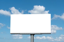 Out door billboard on blue sky background with clipping path