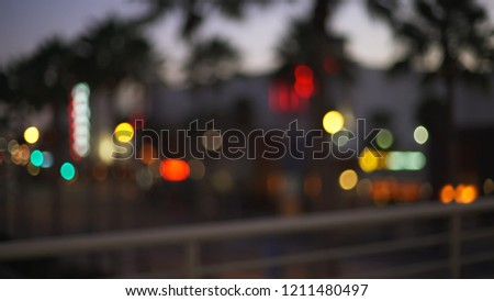Stock Photo Out of focus background plate of city at night with railing in foreground