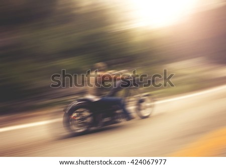 out of focus biker on mountain...