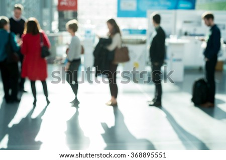 out of focus shot of people waiting in line