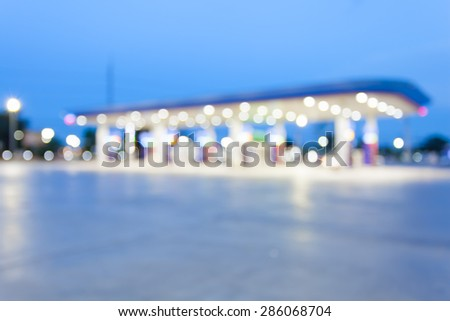 out of focus twilight gas station