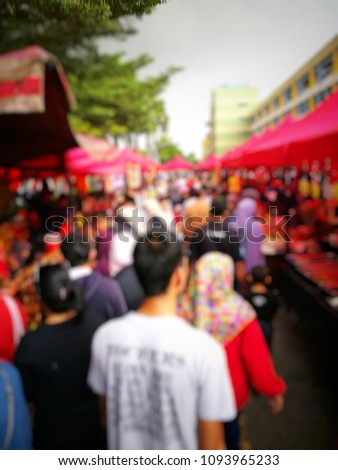 Out of focused crowded people buying and selling food at bazaar Ramadhan in Malaysia. Ramadhan here is known as fasting month. Keywords contain local words. #1093965233
