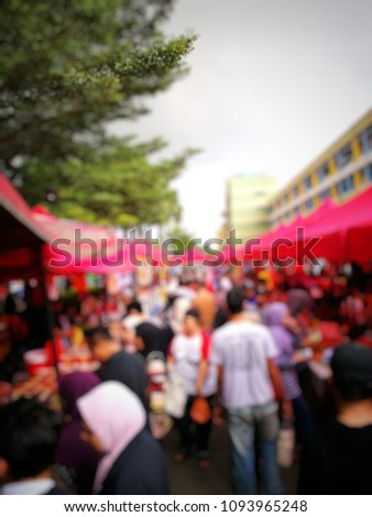 Out of focused crowded people buying and selling food at bazaar Ramadhan in Malaysia. Ramadhan here is known as fasting month. Keywords contain local words. #1093965248