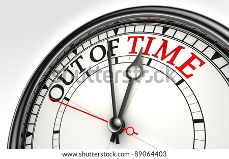 out of time red black words on concept clock closeup on white background metaphor