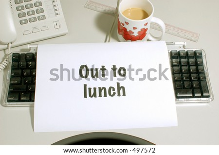 out to lunch sign on computer keyboard