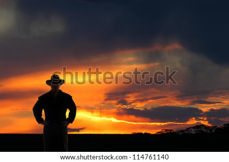 Outback cowboy at sunset