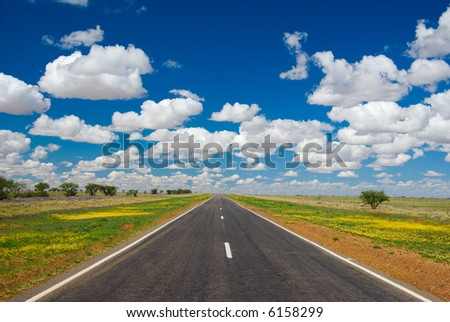 Outback highway stretching to the horizon (Barkly Hwy between Cloncurry and Winton, outback Queensland, Australia)