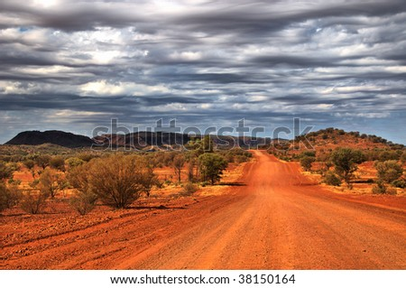 Outback scenery in the Red Centre of Australia (NT), dirt road near Alice Springs