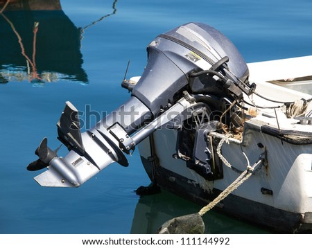 outboard engine on the plastic boat