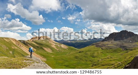 Outdoor Adventure Panorama. Hiker enjoys grand view of alpine tundra in Colorado, USA.