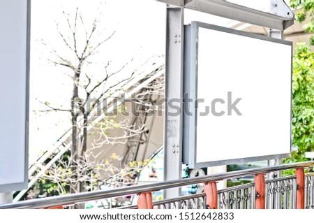 Outdoor advertising. blank advertising billboard at skywalk in city #1512642833