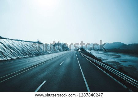 Outdoor asphalt roads and mountains in Asia. #1287840247