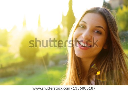 Outdoor atmospheric lifestyle photo of young beautiful lady.  Warm spring. Warm autumn. #1356805187