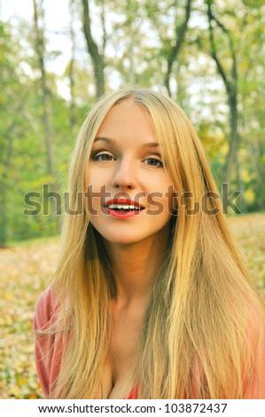 Outdoor autumn  portrait of beautiful girl