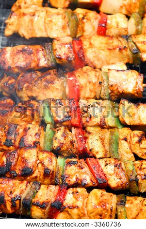 outdoor barbecue of chicken with pepper and sauce