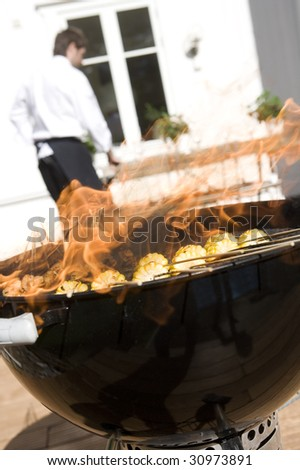 Outdoor barbecue with corn on the grill