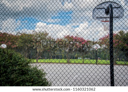 Outdoor basketball Court through Fence  #1160321062