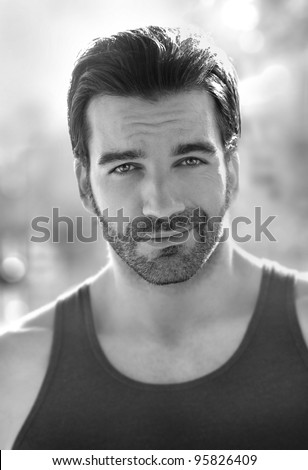 Outdoor black and white portrait of a classically good looking masculine man outdoors