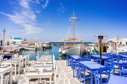 Outdoor cafe bar in Naousa, Greek fishing village on Paros island, Greece. Popular tourist travel destination in Europe