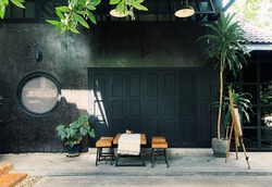 Outdoor cafe decorated in vintage style Decorated with tropical plants.