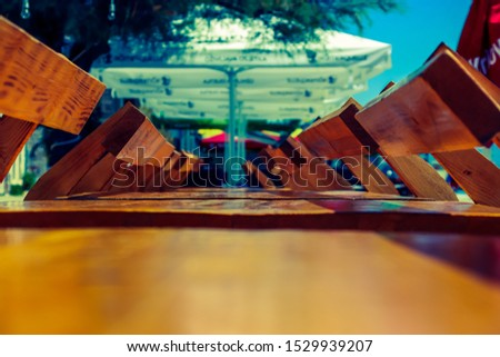 Outdoor cafes. Tables outside with chairs. #1529939207
