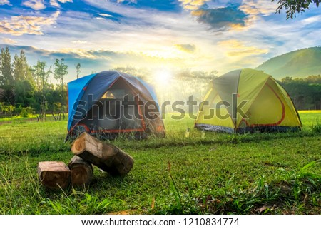 Outdoor camping scenery with sunny day and background of mount,Morning light.Tourists camped in the woods on the hillside.There are many tourist attractions in Thailand. #1210834774