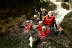 outdoor canyoning active group adventure water sport fun expedition river partnership of energetic teen human during a canyoning expedition in ecuadorian rainforest outdoor canyoning active group adve