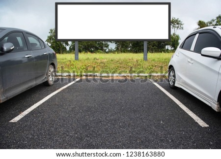 outdoor car parking and empty white billboard .Blank space for text and images. #1238163880