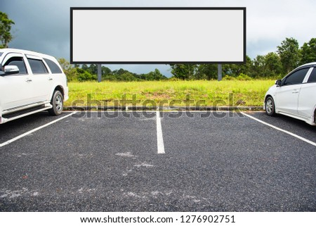 outdoor car parking and empty white billboard .Blank space for text and images. #1276902751