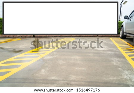 outdoor car parking and empty white billboard .Blank space for text and images. #1516497176
