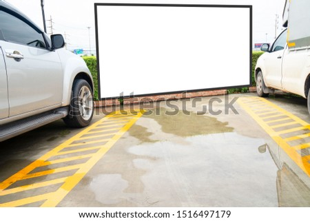 outdoor car parking and empty white billboard .Blank space for text and images. #1516497179
