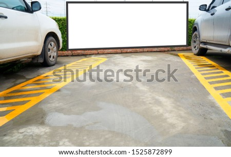 outdoor car parking and empty white billboard .Blank space for text and images. #1525872899