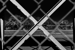 Outdoor chain link fence with steel beam background. Abstract art and design. Industrial art and design. Balanced image. Minimal design and art. Park outdoor design.