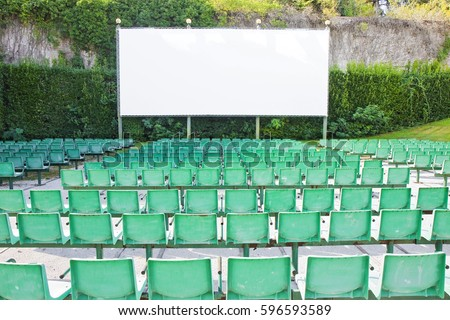 Outdoor cinema with white projection screen #596593589