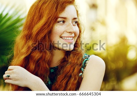 Curly natural redhead eventually