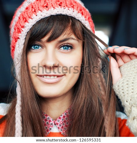 Outdoor closeup portrait of young girl in winter or cold spring