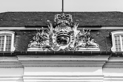 Outdoor coat of arms rooftop decoration in Rococo style on the facade of the Old Town Hall building in Market Square (Marktplatz) completed in 1780 in Bonn, North Rhine Westphalia, Germany