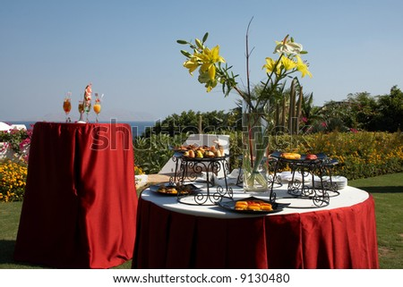 outdoor cocktail party with snacks in seaside resort