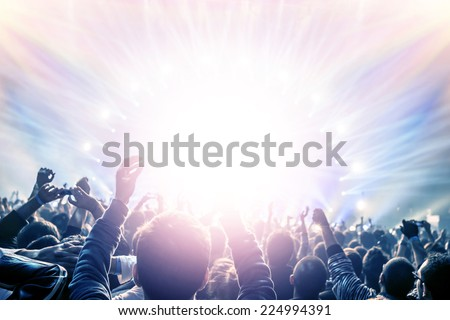 Outdoor concert, happy people with raised up hand enjoying night in the club, night entertainment, active lifestyle, New Year celebration, partying concept
