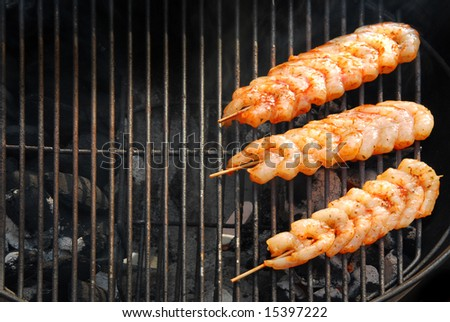 Outdoor cooking in summertime with shrimps on bbq