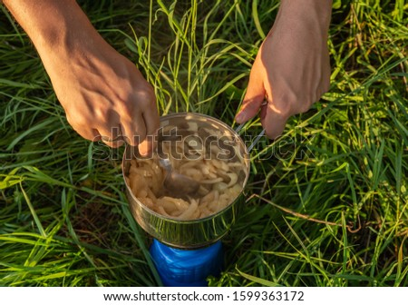 Outdoor cooking. Survival cooking. Camping cooking.