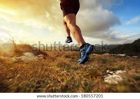 Outdoor cross-country running in early sunrise concept for exercising, fitness and healthy lifestyle #180557201