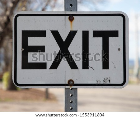 Outdoor Exit Sign on sign post #1553911604
