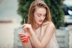 Outdoor fashion beauty portrait of glamour elegant lady, amazing long hairs, drinking tasty cold cocktails, city cafe terrace, travel, joy, relax.