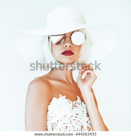 Outdoor fashion photo of young beautiful lady in hat and sunglasses. Summer Beach travel. Summer vibes