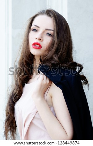 outdoor fashion portrait of young beautiful woman with long hair